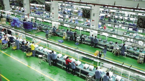 格兰仕引进全球第一条微波炉全自动化生产线