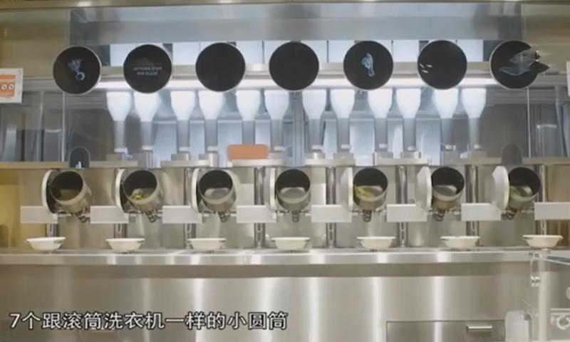 高校食堂自动炒菜机30秒可出餐,同学评论这样做菜是没有灵魂的!